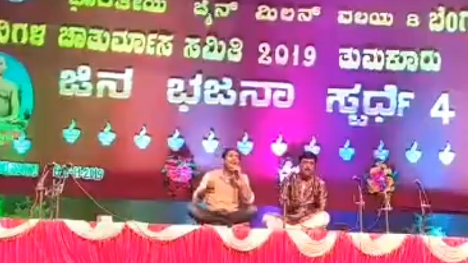 sharan sings dvotional song at an evernt in tumkur